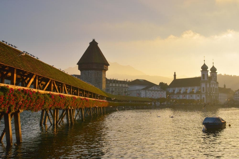 Take a walk through the iconic Chapel Bridge of Lucerne