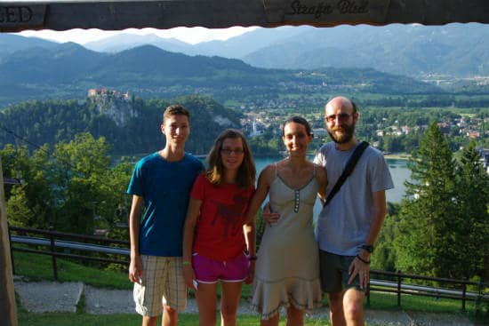 Interrail customer testimonials | Four families with a town view in the background