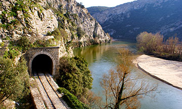train-next-to-river-in-greece